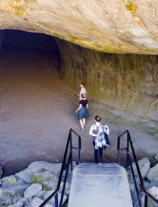 hikers entering cave