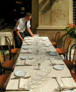waiter preparing a table in Italy