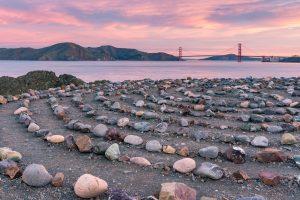 dawn at a stone labyrinth on the coast