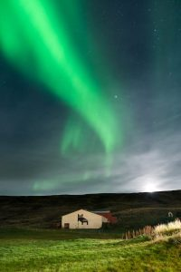 aurora above icelandic guesthouse