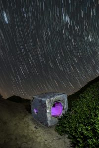 star trails and concrete cube