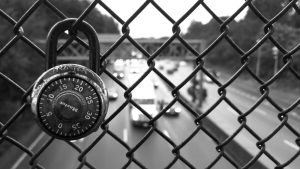 lock attached to chain link fence