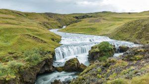 river winding through a green valley