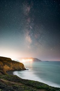 the milky way above a pacific coast town
