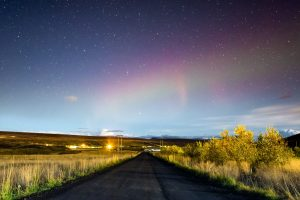 aurora above icelandic road