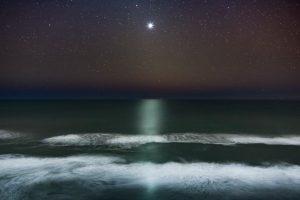 venus rising over the pacific ocean