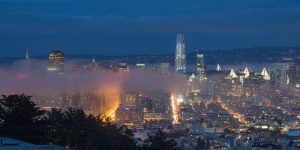 san francisco skyline at blue hour with fog rolling in
