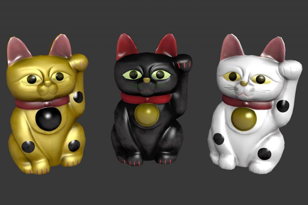 Three maneki-neko cat statues