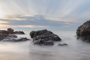 rocks surrounded by incoming tide