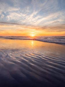 ripples in the sand at sunset