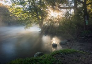 mist rising from a river in the morning